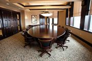 The large, stately executive board room has an oval Cipelli table made by Bittners' custom woodworking shop.
