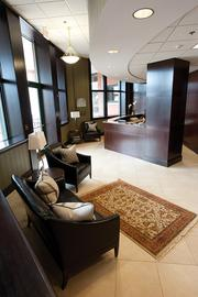The first-floor reception area, shown at left, was upgraded with dark wood walls and soft green wallcoverings - traditional materials the bank was familiar with.