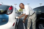 Arthur Wilson demonstrated how to recharge a MiEV, Mitsubishi innovative Electric Vehicle, on the lot at Swope Auto Group.