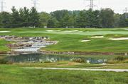 Additional bunkers were added along this water feature on the seventh fairway.