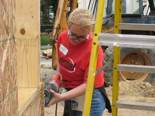 A Wells Fargo employee participated in a Habitat for Humanity of Metro Louisville home-building project in 2011.