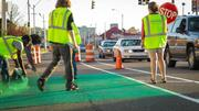 Crews painted temporary bicycle lanes along Cleveland Street for the MEMFix event held Saturday.