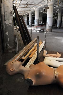 Disfigured mannequins litter an old loading area at the Sears Crosstown facility