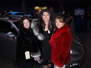 MBJ Book of Lists gala attendees try on furs from event sponsor Holloway Furs