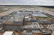 Memphis International Airport's Ground Transportation Center, as seen from the catwalk of the new air traffic control tower, is under construction.