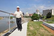 Jimmy Ogle, community engagement manager with Riverfront Development Corp., walks along the project's grass roof.