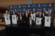 New ownership group of Memphis Grizzlies surrounds majority owner Robert Pera, seated at left.