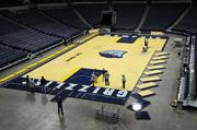 Crews work to install the Memphis Grizzlies new basketball floor at FedExForum.