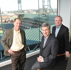 Ralph Berry, Brian Sullivan and Bob Vornbrock inside Sullivan Branding's new office space in Downtown Memphis overlooking AutoZone Park baseball field.