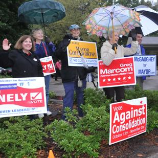 Supporters of various candidates at a voting precinct Nov. 2 on Germantown Road also urged voters to defeat the consolidation of city and county governments, and they did.