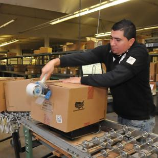 Anelsis Avila works on packaging at Dunavant warehouse. The former cotton merchandiser is shifting to moving other businesses' products.