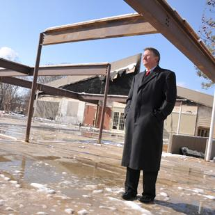 Jim Shoemaker stands on the site of his former office building, which burned Oct. 25. Thanks to  a contingency plan, the business was up and running the next day.