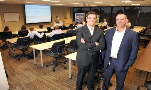 Demetri Patikas and Duncan Williams at Duncan-Williams Inc.'s professional development program, which trains newcomers in financial advising as well as community service.