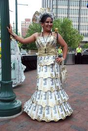 Gown by Waheed Qayumi of Oak Hall made entirely of disgarded cigarette cartons