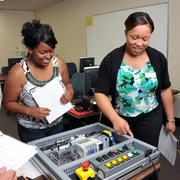 Students Ashley McNeil and Felishia Abrams check out machinery as part of Southwest Tennessee Community College Industrial Readiness Training Program.