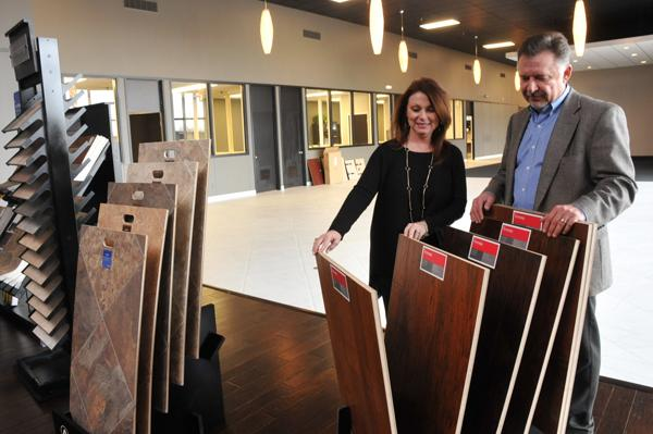 Sherri and Barry Griffith with flooring samples at Artisent Floors' new retail showroom at former Samuels Furniture building