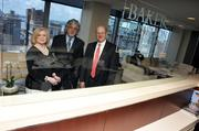 Baker Donelson administrator Joyce Rhodes with shareholders Mark Glover and Ben Adams at the law firm's headquarters