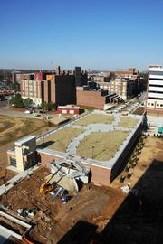 Memphis Specialized Laboratory, nearing completion on site of former Baptist Hospital, features a green roof with grass that will be irrigated by recycled rainwater.