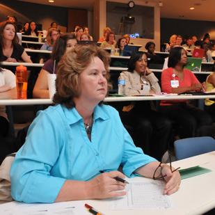 Tommie Norris evaluates student presentations by Clinical Nurse Leader students at UTHSC.