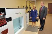 Campbell Clinic COO Sarah Maurice and CEO George Hernandez with water treadmill in rehab area