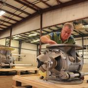 DMN Inc. general manager Chris Williams inspects new shipment of industrial valves at the firm's new facility, which it is transforming into production for Belgium-based DMN Valves