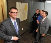 Vita Brevis Arts Bureau president John Weeden with Northwestern Mutual Financial Network clients in their Forum III offices