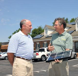 Scott Edwards — with solar consultant Peter Calandruccio — invested in a solar array at his dental office, thanks in large part to TVA incentives.