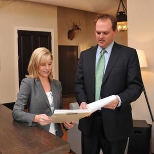 Elizabeth and Ben Daniel go over a client's file at Daniel Law Firm's new, expanded offices at 145 Court St. Downtown.
