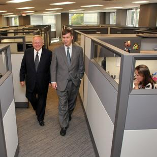 Evolve Mortgage president Jeff Kuehn and Evolve Bank CEO Scott Stafford at the firm's new headquarters in Triad Centre III in the Poplar Corridor