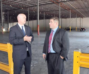 Mark Littleton and Greg White stand in Expeditors International's third-party distribution facility, a 133,382-square-foot facility in Southeast Memphis.