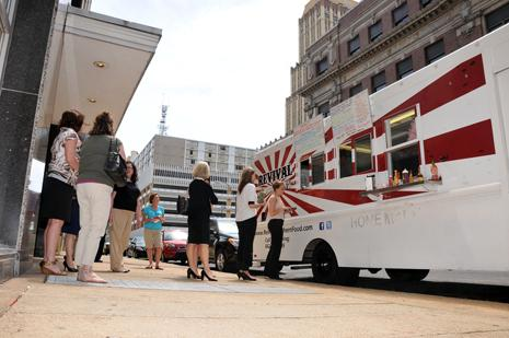 Downtown Memphis workers line up for lunch at Revival Southern Food Truck on Second Street near Court Avenue. Local mobile food truck businesses are growing.