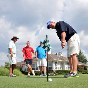 Jim Martin, Josh Edge, Nick Chaisson and Brian Alexander putt at Quail Ridge Golf Course in Bartlett.