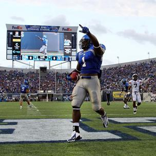 University of Memphis running back Jerrell Rhodes scores a touchdown in the Tigers' season opener against UT-Martin. The moment is captured on the stadium's new 50-by-100 jumbotron.
