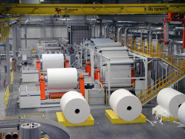 Huge rolls of toilet tissue in Kruger's expanded manufacturing facility await processing.
