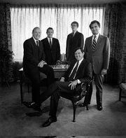 Morgan Keegan Executive Committee, early 1980s: James Keegan, John Stokes Jr., William Deupree, Joseph Weller and Allen Morgan (seated)