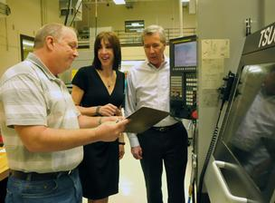 Tim Gooch, Barbara Tatge and Gary Tatge at Odyssey Medical's labs on Brother Boulevard