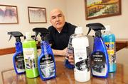Optimum Polymers Technologies founder and president David Ghodoussi with a few of his company's automotive wash and wax products. Ghodoussi recently received an EDGE Impact Loan to expand his business.