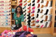 Rashana Banks arranges items at one of 10 City Gear stores in Memphis. City Gear will get Black Friday started early with one of its 'door buster' sales on Nov. 17.