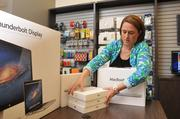 Mignonne Wright, owner of MacAdvantage in Memphis, expects Apple's iPad Minis and other MacIntosh products to fly off her store's shelves this year.