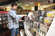 """IN THIS PHOTO: Spin Street general manager Dan O'BrienThe music and movie retail industry may have been hit the hardest by the digital wave, but Spin Street, at Poplar Avenue and Highland Street, is still surviving. General manager Dan O'Brien said the holidays are important because people need to be able to see, touch and feel gift ideas. """"Often during the holidays, people just need to browse,"""" he said. During the holidays, Spin Street adds items like calendars, toys and gift sets which are unlikely to appear on its shelves in other times of the year."""