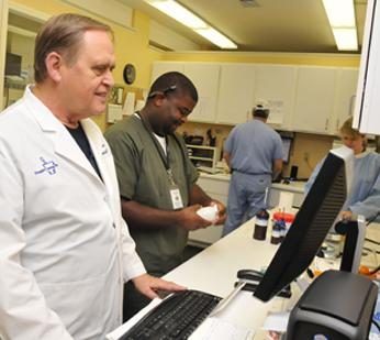 Bill Johns and Antonio Anderson in the pharmacy preparation area at People's Custom Rx, which has developed a reputation for custom compounded prescriptions.