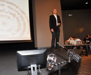 David Traxler, CEO of startup business Friendsignia, rehearses for Seed Hatchery's Investor Day presentations held May 3 at a Bioworks Foundation auditorium.