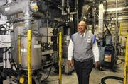 TC Jones, Sharp Manufacturing's vice president of human resources, strolls through reopened toner plant.