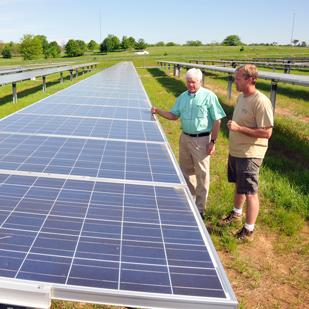 John Charles Wilson and Brian Lechliter at the Agricenter's solar panel array off Walnut Grove in East Memphis