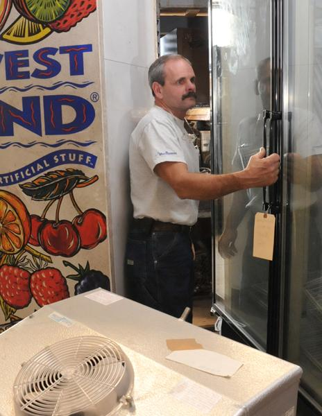 Chuck Frayser prepares to move a refrigerator for delivery. Maintaining a long-term work force has helped his company weather the ups and downs of the economy.