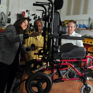 Teresa Glass Owens, Nebraska Wade and Forrest Owens adjust a custom wheelchair at Glass Seating and Mobility, which could see revenue double from 2011 to 2012.