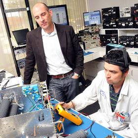 Marcellus Montalvo and Mario Ordonez of InterSky Precision Instruments perform tests on electronic components used in the aviation industry.