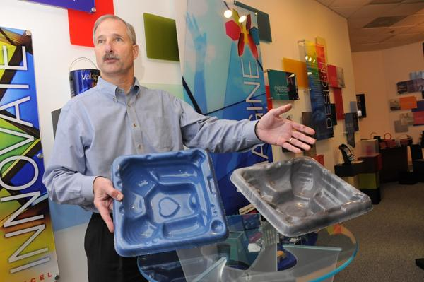 Chris Robinson, cast sheet manager at Lucite International in Cordova, shows a new line of acrylic casts. Local designer Beth Almond helped develop the new colors.