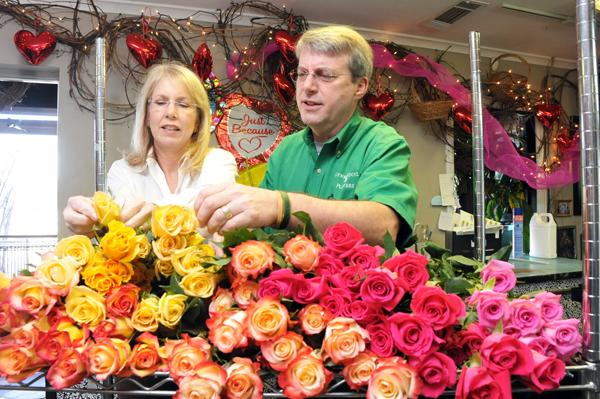 Lane and Michael Doyle prepare an arrangement at Doyle Flowers. The company has acquired Boggan's Florist and the two companies now share space in East Memphis.