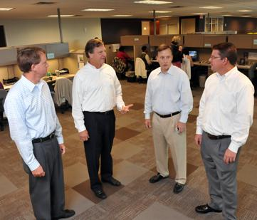 Unified Health Services' Michael Reece, Doug Marchant and Joe Ward with Paradigm's Tracy Speake (second from right) in Unified's new office space